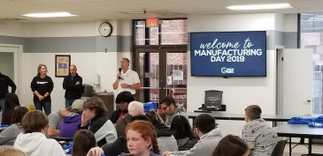 Mark Chalfant, Fuller Brush CEO, talks with students